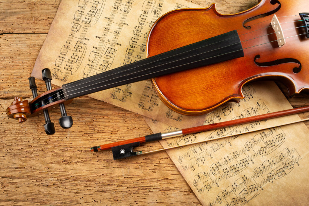 Classical violin and old music parchment.